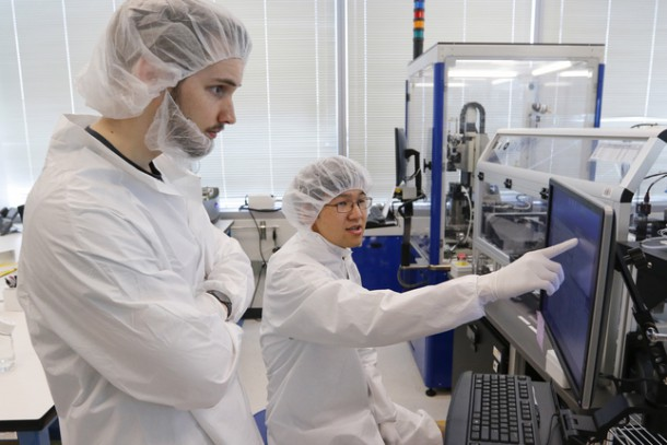 Technician James Horsfall, left, and engineer Austin Hsiao work on a project at Twist Bioscience in San Francisco, Calif., on Friday, June 19, 2015. Twist receives emails from scientists seeking of a specific genetic sequence. Then they make the gene, using silicon engineering and chemical techniques, and mail it back. (John Green/Bay Area News Group)